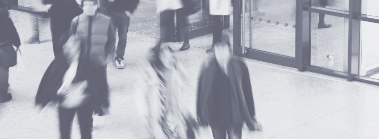 blurred black and white image of people leaving an insurance agency in salt lake