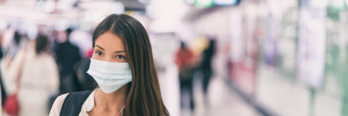 a woman in California wearing a mask in her workplace during the COVID-19 pandemic. Learning about the new COVID-19 legislation.
