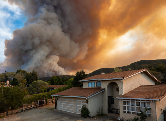 a wildfire comes close to homes
